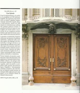 Portone storico in legno scolpito a Torino